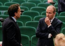 Leo Varadkar and Micheál Martin discussing the new Irish government Saturday after Martin's election as Taoiseach.
