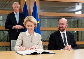 European Commission President Ursula von der Leyen and European Council President Charles Michel signing the EU-UK Withdrawal Agreement today, with Michel Barnier in the background.